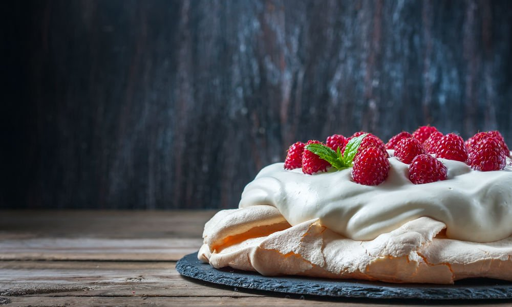 THIS VALENTINE'S DAY DIG INTO A DREAMY PAVLOVA WITH CREAM & BERRIES
