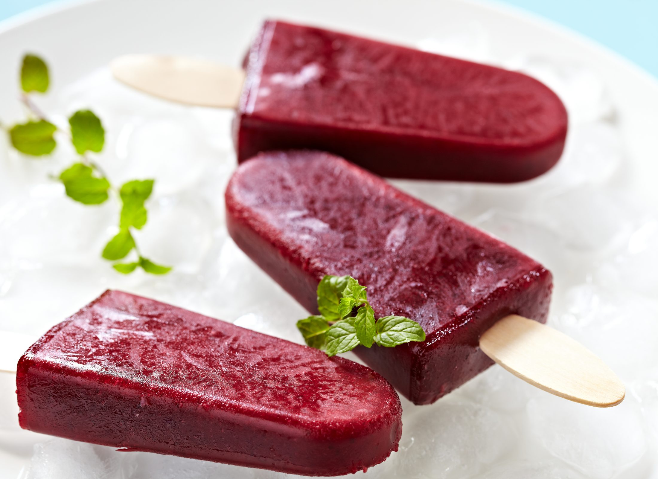 Red matcha popsicles on ice